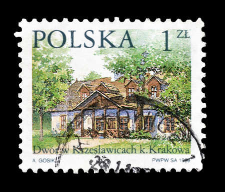 philately: Cancelled postage stamp printed by Poland, that shows country house, circa 1999.