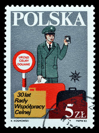 philately: Cancelled postage stamp printed by Poland, that shows Customs officer, circa 1983. Editorial