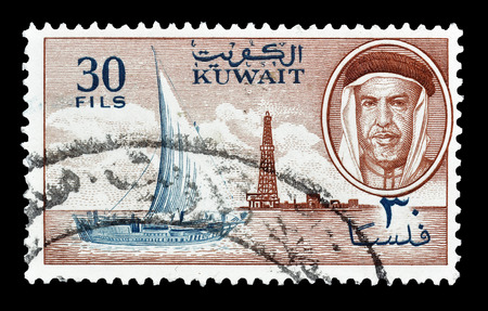 sheik: Cancelled postage stamp printed by Kuwait, that shows Dhow,derrick and sheik, circa 1960.