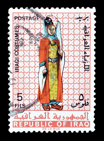 iraqi: Cancelled postage stamp printed by Iraq, that shows Iraqi costume, circa 1967. Editorial