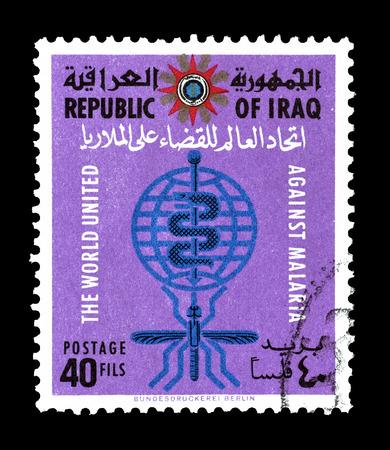 eradication: Cancelled postage stamp printed by Iraq, that shows Malaria Eradication Emblem, circa 1962.