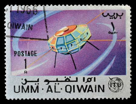 philately: Cancelled postage stamp printed by Umm Al Qiwain, that shows Satellite, circa 1966. Editorial
