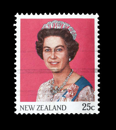 queen elizabeth ii: Cancelled postage stamp printed by New Zealand, that shows Queen Elizabeth II, circa 1985.