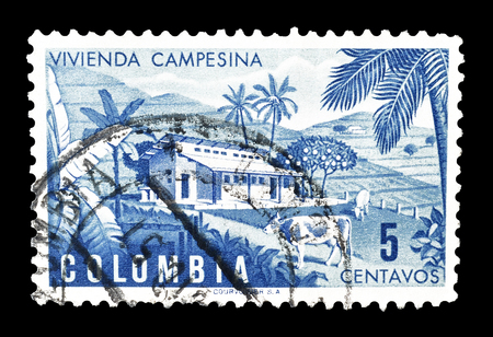 colombian: Cancelled postage stamp printed by Colombia, that shows Colombian farm, circa 1950.