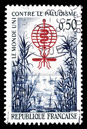 eradication: Cancelled postage stamp printed by France, that shows Malaria eradication emblem and swamp, circa 1962.