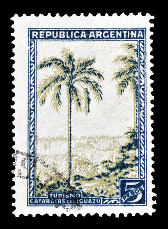 philately: Cancelled postage stamp printed by Argentina, that shows Iguacu falls, circa 1936. Editorial