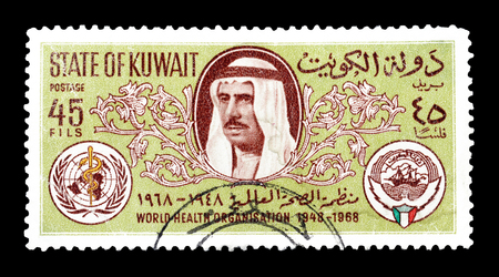 sheik: Cancelled postage stamp printed by Kuwait, that shows Sheik Sabah, Arms of WHO and Kuwait, circa 1968.
