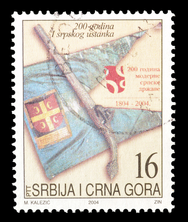 serbia and montenegro: Cancelled postage stamp printed by Serbia and Montenegro, that shows Symbols of resistance, circa 2004.