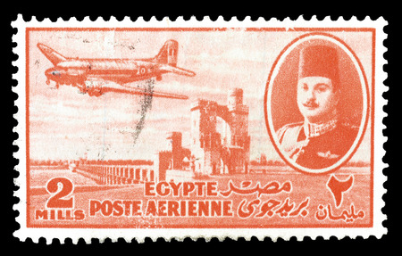 farouk: Cancelled postage stamp printed by Egypt, that shows king Farouk Delta Dam and airplane, circa 1947.