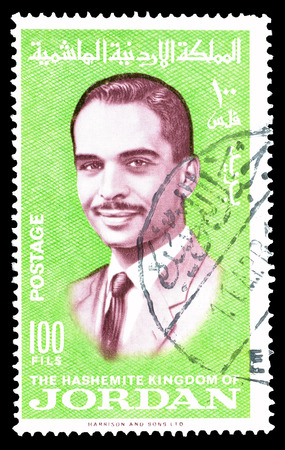 king hussein: Cancelled postage stamp printed by Jordan, that shows king Hussein, circa 1966.