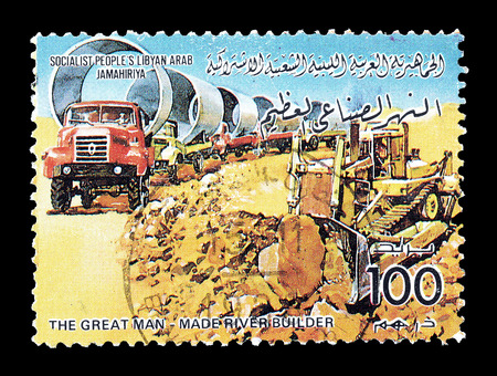 hauling: Cancelled postage stamp printed by Libya, that shows Trucks hauling pipes, circa 1986. Editorial