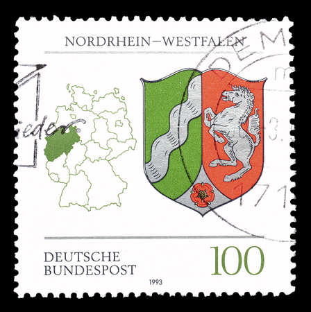 westfalen: Cancelled postage stamp printed by Germany, that shows Map and emblem of Westfalen circa 1992. Editorial
