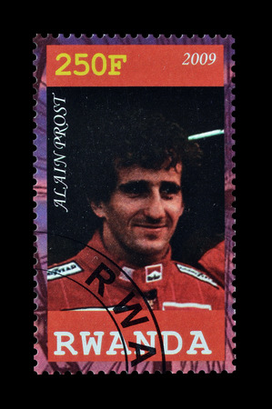 prost: Cancelled postage stamp printed by Rwanda, that shows Alain Prost, circa 2009. Editorial