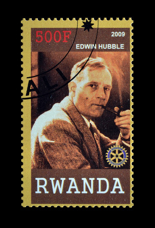 philately: Cancelled postage stamp printed by Rwanda, that shows Edwin Hubble, circa 2009. Editorial