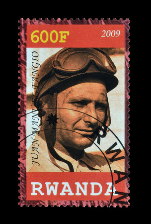 philately: Cancelled postage stamp printed by Rwanda, that shows Fangio, circa 2009.