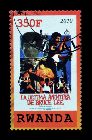 philately: Cancelled postage stamp printed by Rwanda, that shows Bruce Lee circa 2010.
