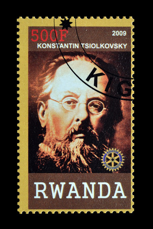 konstantin: Cancelled postage stamp printed by Rwanda, that shows Konstantin Tsiolkovski, circa 2009.