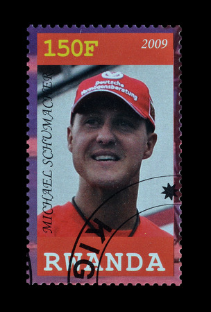 Cancelled postage stamp printed by Rwanda, that shows Michael Schumacher, circa 2009. Editorial