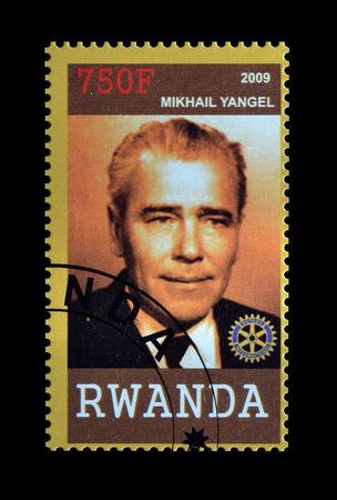mikhail: Cancelled postage stamp printed by Rwanda, that shows Mikhail Yangil, circa 2009.