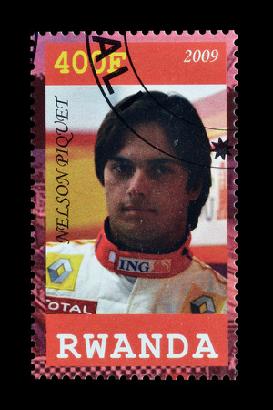 nelson: Cancelled postage stamp printed by Rwanda, that shows Nelson Piquet, circa 2009. Editorial