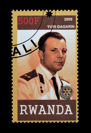yuri: Cancelled postage stamp printed by Rwanda, that shows Yuri Gagarin, circa 2009.
