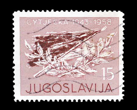 philately: Cancelled postage stamp printed by Yugoslavia, that shows flag and laurel, circa 1958.