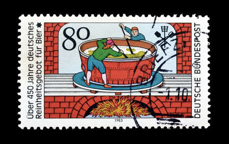 pureness: Cancelled postage stamp printed by Germany, that celebrates 450th anniversary of beer pureness law., circa 1983.