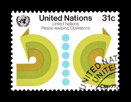 promotes: Cancelled postage stamp printed by United Nations, that promotes peace keeping operations, circa 1980. Editorial