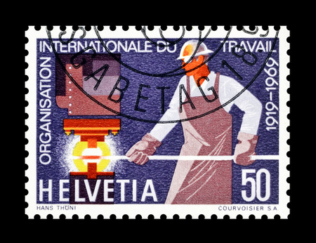 blacksmith: Cancelled postage stamp printed by Switzerland, that shows Blacksmith, circa 1969.