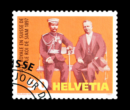 adolf: Cancelled postage stamp printed by Switzerland, that shows Chulalongkorn and Adolf Deucher, circa 1997.