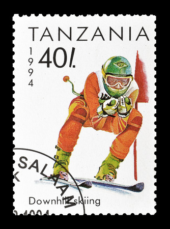 philately: Cancelled postage stamp printed by Tanzania, that shows Downhill skiing, circa 1994.