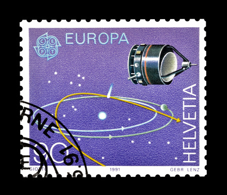 orbits: Cancelled postage stamp printed by Switzerland, that shows Space probe Giotto and orbits, circa 1991. Editorial