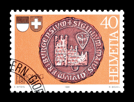 freiburg: Cancelled postage stamp printed by Switzerland, that shows City seal of Freiburg, circa 1981. Editorial
