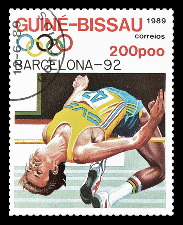 guinea bissau: Cancelled postage stamp printed by Guinea Bissau, that shows High jump, circa 1989 Editorial