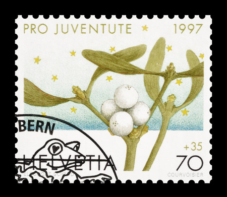 philately: Cancelled postage stamp printed by Switzerland, that shows Mistletoe, circa 1997.