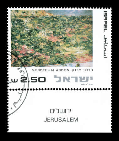 philately: Cancelled postage stamp printed by Israel, that shows painting by Mordechai Ardon,circa 1980.