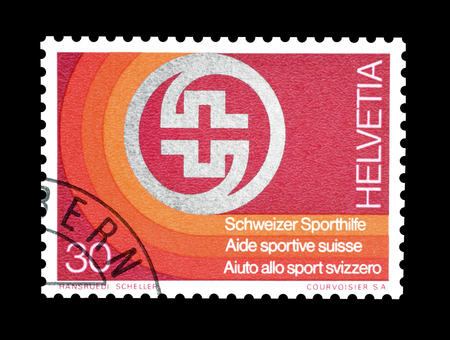 swiss insignia: Cancelled postage stamp printed by Switzerland, that shows Badge of Swiss Sport Aid, circa 1974.