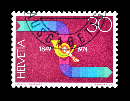 posthorn: Cancelled postage stamp printed by Switzerland, that shows Post horn, circa 1974. Editorial