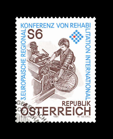 philately: Cancelled postage stamp printed by Austria, that shows Man in wheelchair, circa 1981. Editorial
