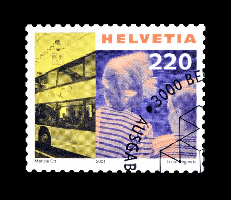 omnibus: Cancelled postage stamp printed by Switzerland, that shows Post omnibus and children, circa 2001. Editorial