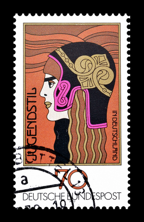 athena: Cancelled postage stamp printed by Germany, that shows Athena head with helmet, circa 1977. Editorial