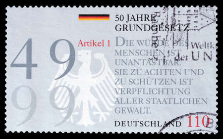 promotes: Cancelled postage stamp printed by Germany, that promotes 50th anniversary of constitution clown drawing, circa 1999. Editorial