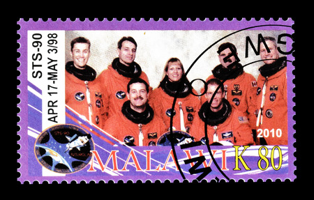 Cancelled postage stamp printed by Malawi, that shows astronauts, circa 2010. Editorial