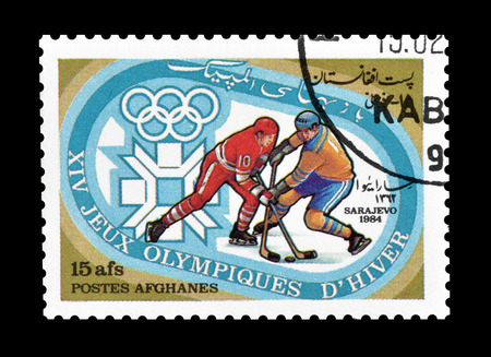 philately: Cancelled postage stamp printed by Afghanistan, that shows Ice hockey, circa 1984. Editorial