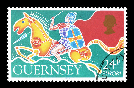philately: Cancelled postage stamp printed by Guernsey, that shows Warrior on horseback, circa 1994.