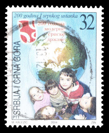 serbia and montenegro: Cancelled postage stamp printed by Serbia and Montenegro, that shows Children and Earth, circa 2004. Editorial