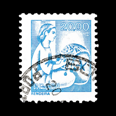Cancelled postage stamp printed by Brasil, that shows Lacemaker, circa 1976.