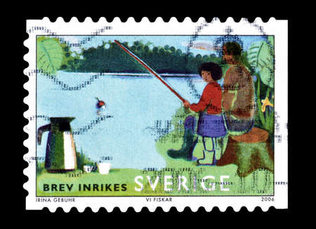 philately: Cancelled postage stamp printed by Sweden, that shows fishing, circa 2006.