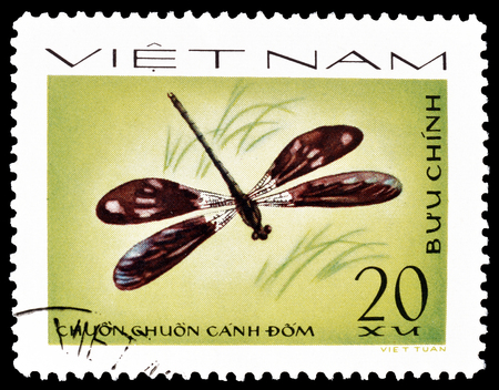 postage: Cancelled postage stamp printed by Vietnam, that shows Dragonfly, circa 1977.
