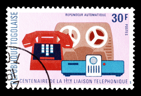 grabadora: Cancelled postage stamp printed by Togo, that shows Telephone, tape recorder and speaker, circa 1976.